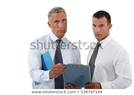 Two concerned businessmen stood with clip board Stock photo © photography33