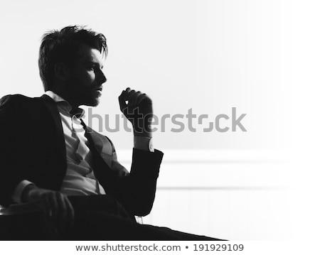 zdjęcie · przystojny · mężczyzna · jasne · garnitur · działalności · biuro - zdjęcia stock © dolgachov