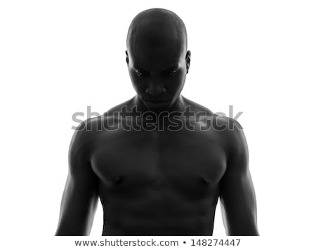 topless young man looks down Stock photo © feedough