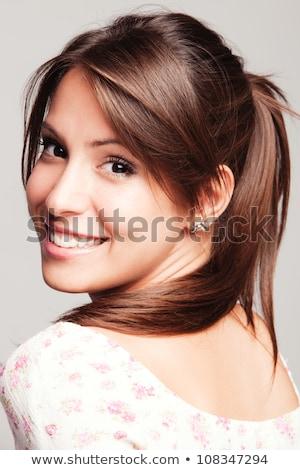 friendly smiling young woman portrait closeup Stock photo © stepstock
