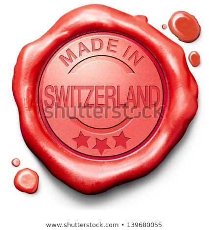 Made in Swizerland - Stamp on Red Wax Seal. Stock photo © tashatuvango
