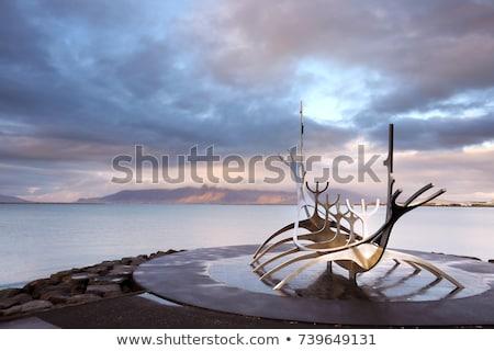 Iceland. Reykjavik. Sun-Craft Metalic Sculpture and Reykjavik Ba Stock photo © ABBPhoto