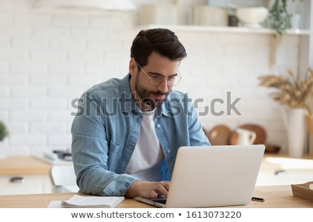 Foto stock: Young Businessman Reads The News