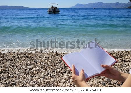 Asian brunette girl lying on the summer beach white sand Stock photo © lunamarina