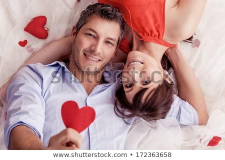 Amoroso Pareja romántica día de san valentín cama champán Foto stock © CandyboxPhoto
