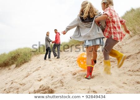 Madre sabbia spiaggia inverno holding hands Foto d'archivio © monkey_business