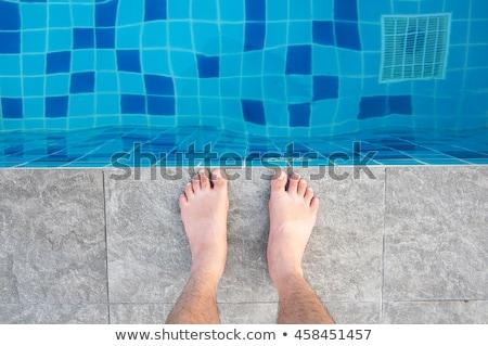 Feet at the edge of the pool Stock photo © saje