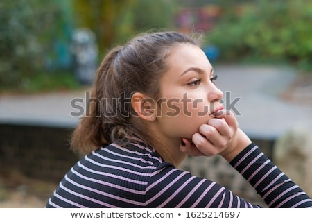 Stock photo: Beautiful young woman daydreaming
