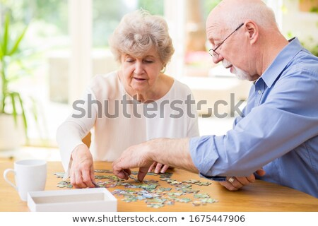 pension on blue puzzle stock photo © tashatuvango