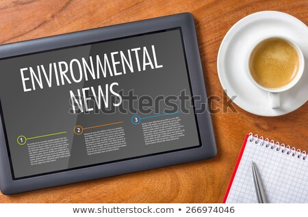 tablet on a wooden desk   environmental news stock photo © zerbor