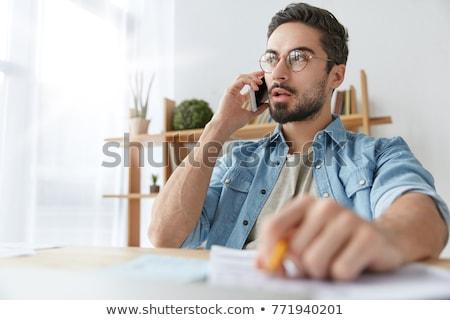 Moço telefonema jovem trabalhador de escritório secretária telefone Foto stock © JamiRae