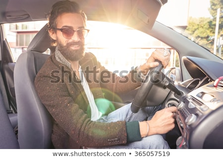 young man in suit driving a car filtered stock photo © nito