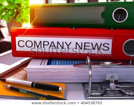 Red Ring Binder with Inscription Company News. Stock photo © tashatuvango