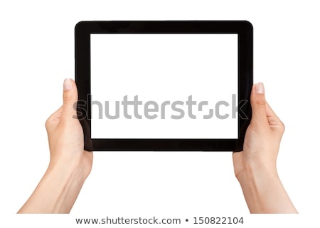 female hand holding a tablet touch computer gadget with isolated Stock photo © tetkoren