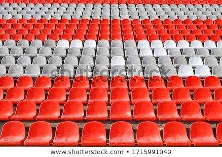 Rows of red empty stadium seats Stock photo © stevanovicigor