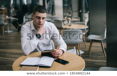 Blank copybook with tablet and smartphone Stock photo © cherezoff