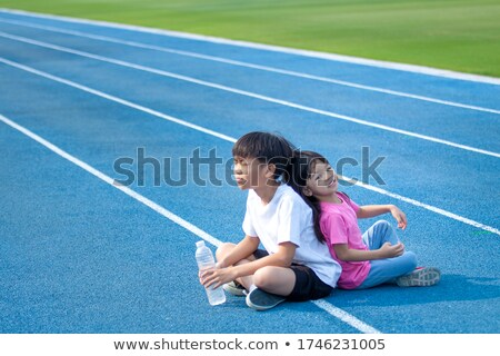 Happy family with little girl go in water, standing back  stock photo © Paha_L