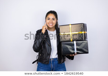 Woman holding gift box and showing finger over lips Stock photo © deandrobot