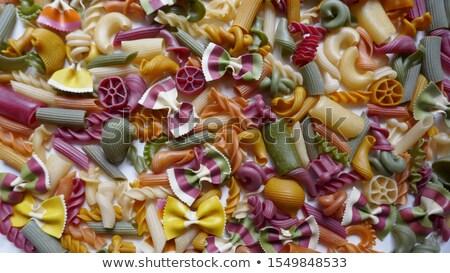 Beautiful homemade  Italian pasta Fusilli from durum wheat on stone background, closeup Stock photo © mcherevan