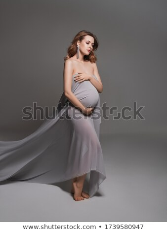 Attractive model wrapped in a veil Stock photo © jrstock
