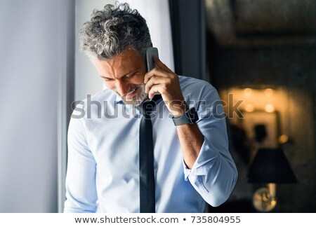 férfi · beszél · telefon · szürke · modell · háttér - stock fotó © Patramansky