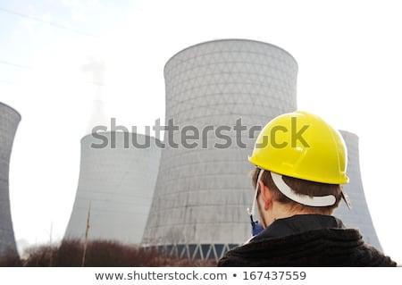 Ingegnere casco piedi nucleare centrale elettrica cielo Foto d'archivio © zurijeta