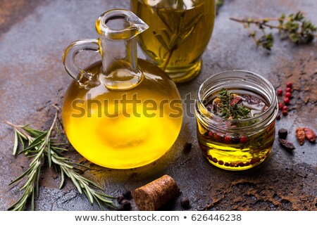 Stock photo: Extra virgin olive oil flavored with rosemary