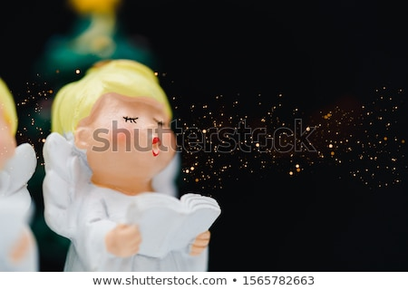 Angel singing carols or worship Stock photo © lovleah