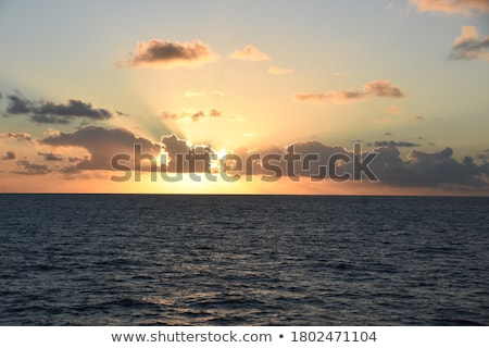 sun behind yellow clouds stock photo © frankljr