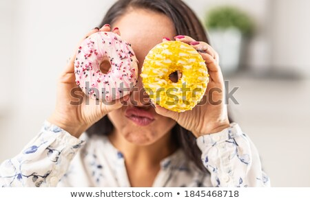 Two women eat different types of food Stock photo © bluering