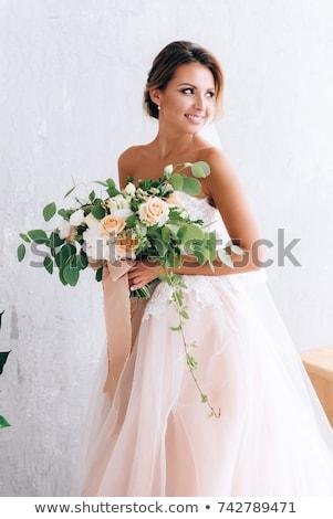 portrait of happy bride with bouquet stock photo © deandrobot
