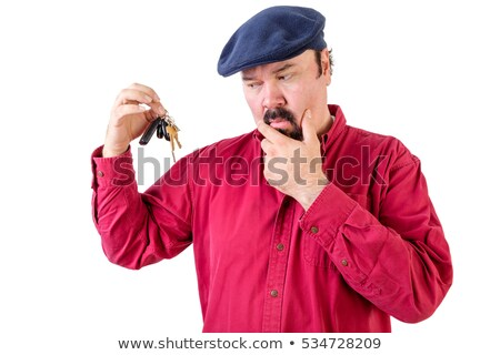 Confused man frowning at a bunch of car keys Stock photo © ozgur