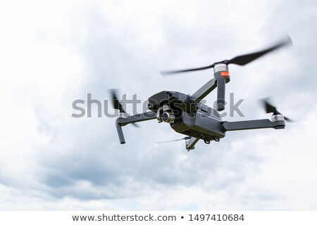 Stock photo: Dron flight on the field.