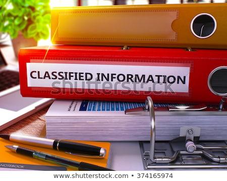 Red Office Folder with Inscription Classified Information Stock photo © tashatuvango