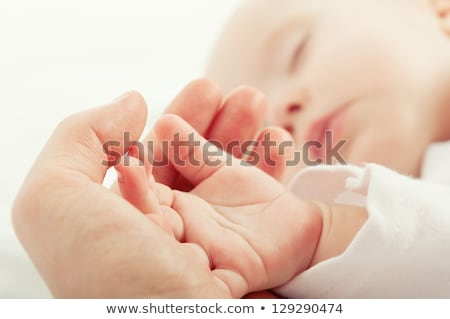 Stock photo: close up of mother and newborn baby hands