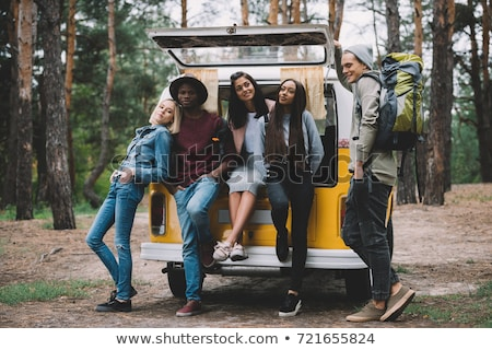 Stock photo: multiethnic friends traveling by minivan