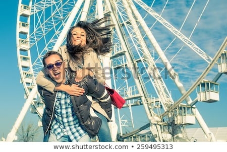 Man giving a girl piggy back ride Stock photo © IS2