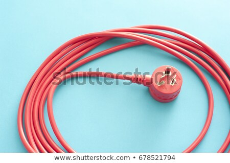 Long wound up red extension cord Stock photo © photohome