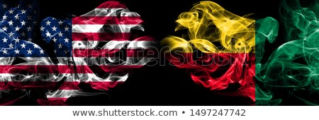 Football in flames with flag of benin Stock photo © MikhailMishchenko