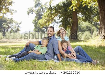 Család ül együtt vidék mező fű Stock fotó © IS2