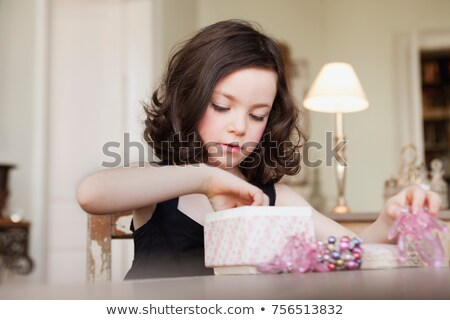 girl exploring contents of parcel Stock photo © IS2