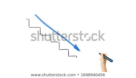 Businessman drawing arrow pointing down Stock photo © stevanovicigor