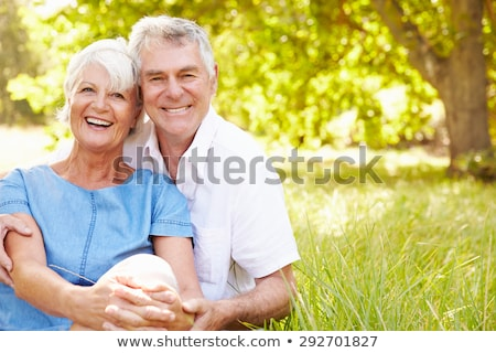 Senior couple smiling to camera Stock photo © IS2