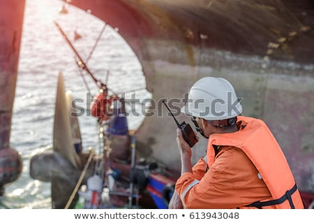 Workers on machinery in shipping yard Stock photo © IS2