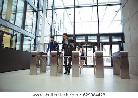 Businesspeople scanning their cards at turnstile gate Stock photo © wavebreak_media