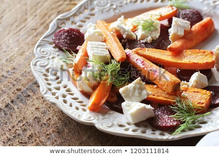 Healthy grilled beet, carrots salad with cheese feta, fennel and Greek yogurt in small glass bowls o Stock photo © Virgin