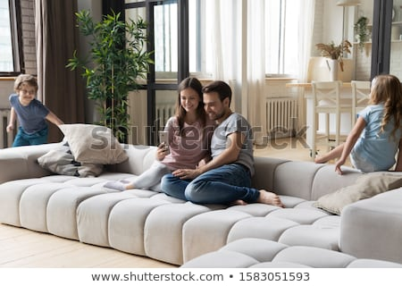 young couple taking selfie on sofa at home stock photo © diego_cervo