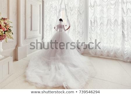 Bride in white wedding dress with long veil Stock photo © artfotodima