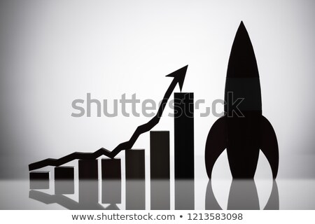 Rocket Besides Graph With An Arrow Moving In Upward Direction Stock photo © AndreyPopov