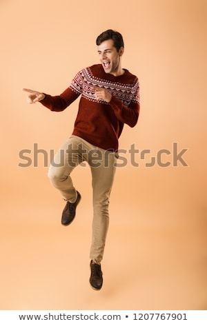 Image of joyful man 20s with bristle wearing knitted sweater poi Stock photo © deandrobot